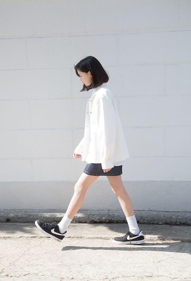 White jacket, jean skirt, socks, and sneakers