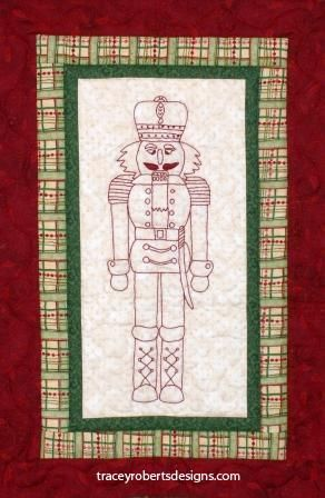 """Nutcracker Christmas BOM block 2 Each of the nine blocks are stitched in red work back stitch embroidery and feature a different Nutcracker including a drummer, a shepherd, a trumpeter and many more. Nutcracker Christmas is a 9 month BOM. The patterns are a PDF digital download that you print or view yourself. Each pattern includes stitching directions and borders for each block.   Each block price - $5 NZD each Finished Quilt measures 46½"""" X 64½"""""""