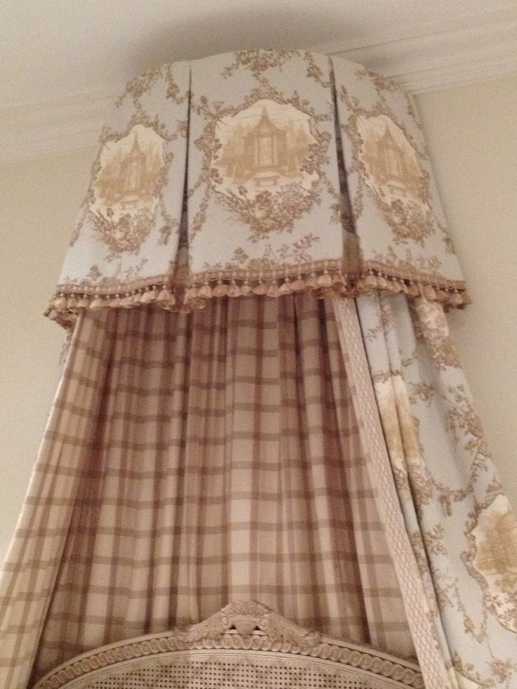 Perfect fabric placement on the bed crown. That's what needs to be done with a medallion fabric like this & you have to work it out mathematically to get it just right. You can't leave it to the workroom's decision. The Enchanted Home