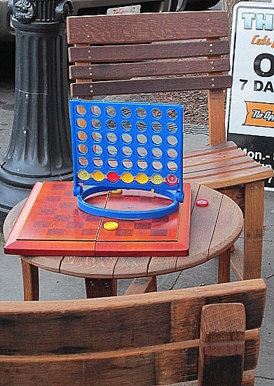 Public checkers on the sidewalk in front of a downtown barber shop (Petaluma; photo by Maya Lea)