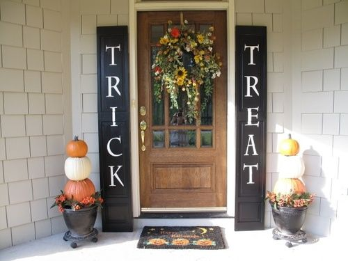 May have to do this next year. 2 cheap panel closet size doors painted with the words. I like it.