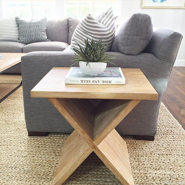 Gray Linen Couch Natural Wood Side Table And Fiber Rug