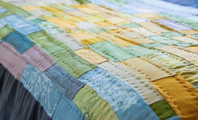 """From """"Printing on Fabric"""" by Jen Swearington.  Looks like a great book about printing, and I love the look of this quilt."""