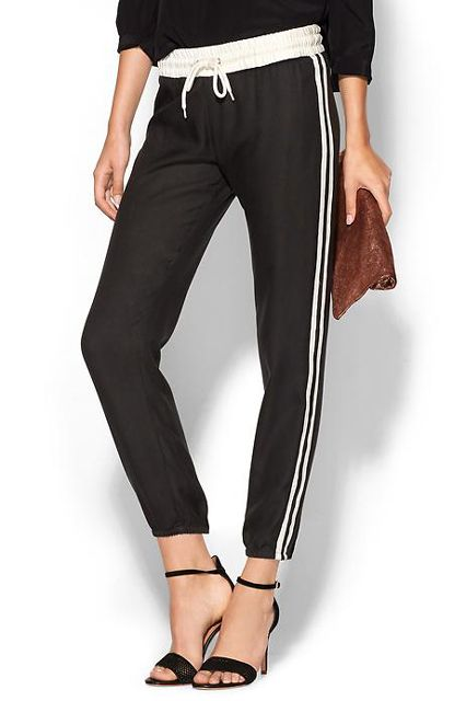16 Sporty Fall Buys We're Wearing Outside The Gym #refinery29  http://www.refinery29.com/sporty-fall-outfits#slide12  Track pants with heels may very well be the most badass date-night outfit, like, ever.