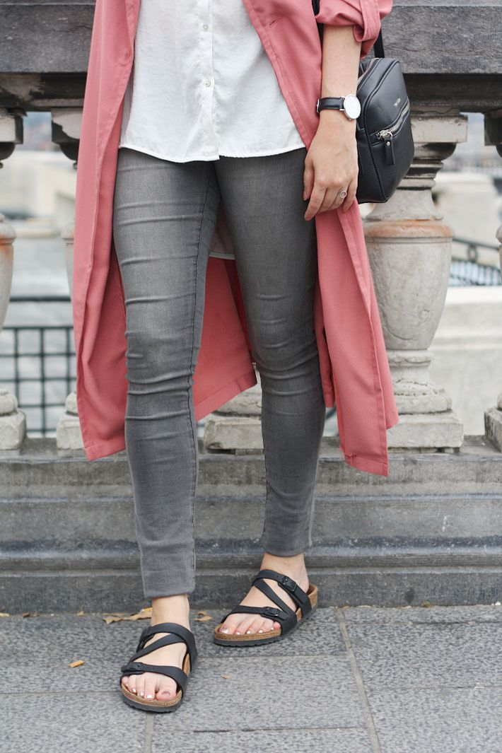 outfit: pink trench coat, grey skinny jeans, Salina Birkenstock sandals