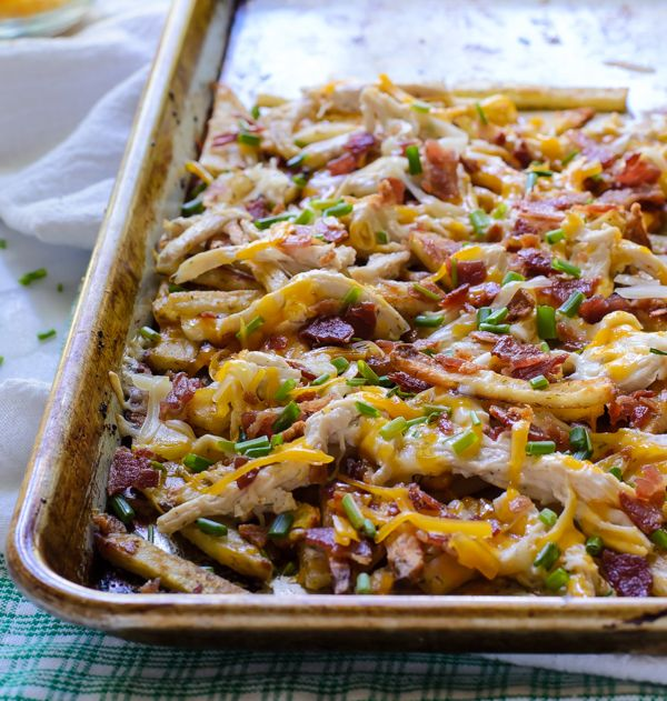Oven baked ranch fries smothered in bacon, two cheeses, and creamy ranch chicken. Homemade French fries do not get any better than this!