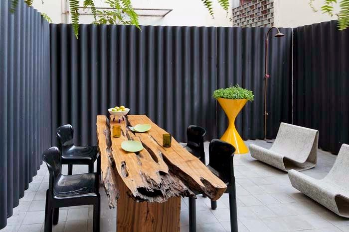 corrugated metal fence painted dark gray