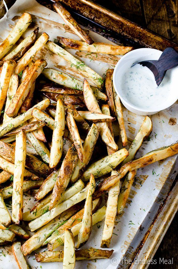 These baked garlic dill French fries are crispy and unexpectedly fresh tasting. The lemon yogurt dill sauce is light and perfect for dipping.