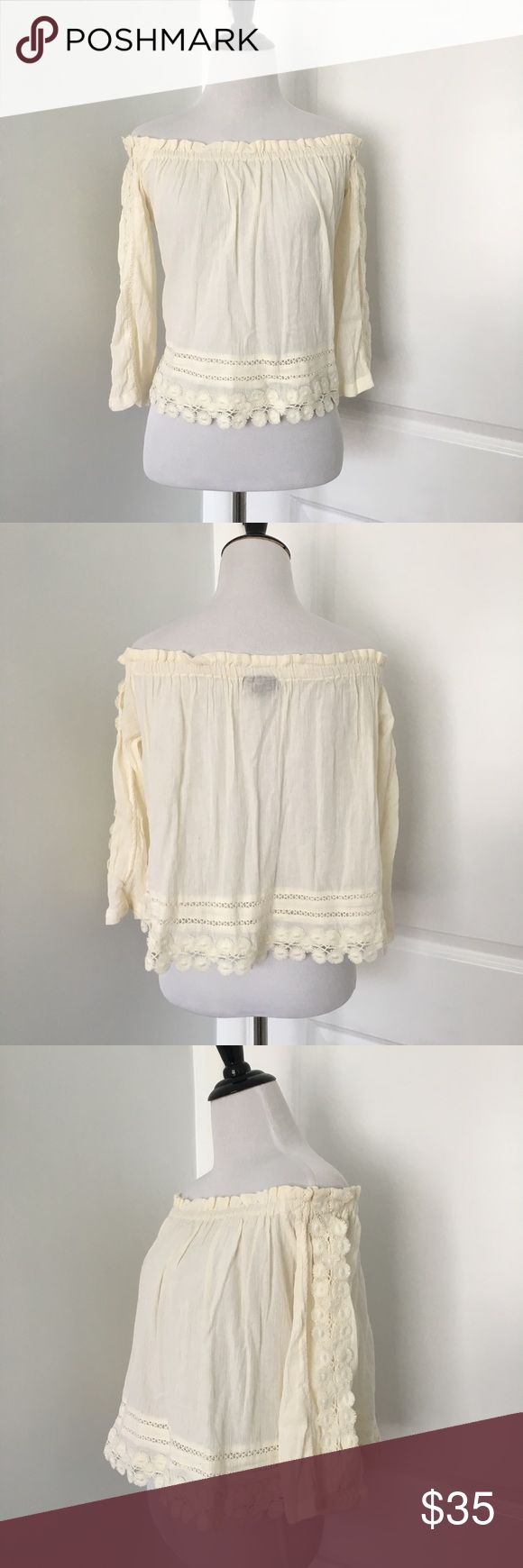 Topshop Bardot Top Super cute cream colored off the shoulder Bardot top with lace. Slightly cropped Brand new, Never worn but does not have tags  Size 6 Topshop Tops Blouses