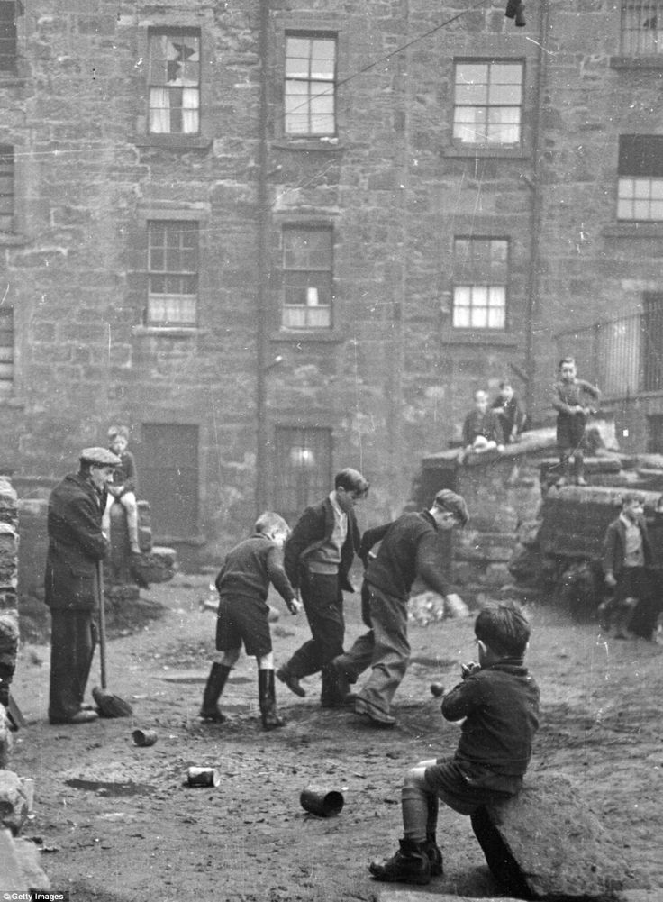 Youngsters enjoy a kickabout in Glasgow in 1948. Bert Hardy himself came from a working-class family and was the eldest of seven children | Photographer:  Bert Hardy, d.1995