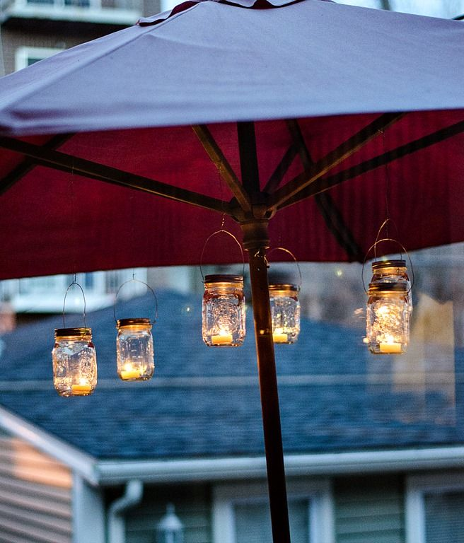 mason jar lanterns for the backyard... great idea to suspend under a patio umbrella!