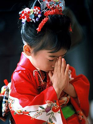 Faith. This has nothing to do with religion! -In Japan (and probably in other parts of The far East) it's called NAMASTE. In Thailand it's called SA-VA-DI-KA(P) and is an everyday greeting.