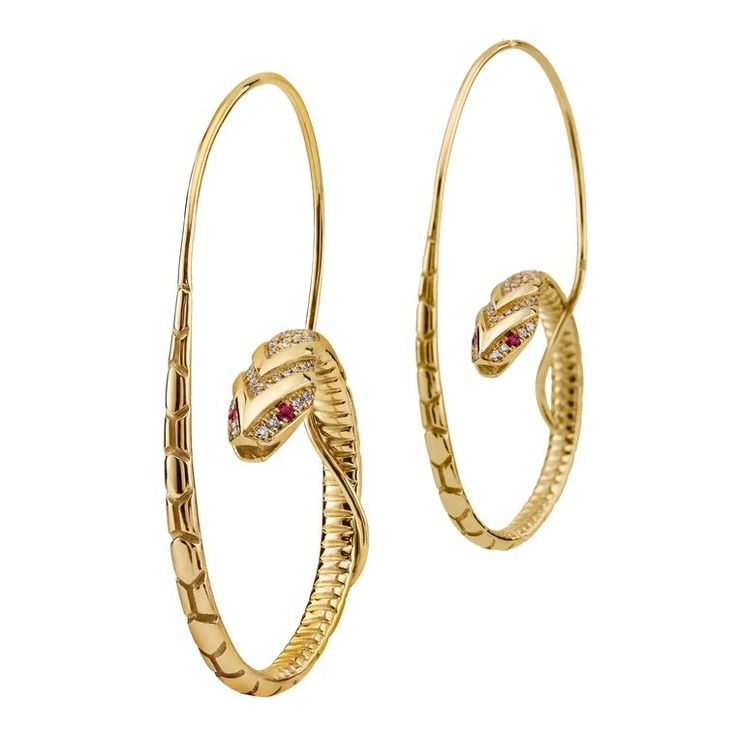 With ruby eyes and white diamond scales, these gold snake hoop earrings give serpent jewellery a modern makeover. http://www.thejewelleryeditor.com/jewellery/article/azza-fahmy-wonders-of-nature-jewellery-collection/ #jewelry