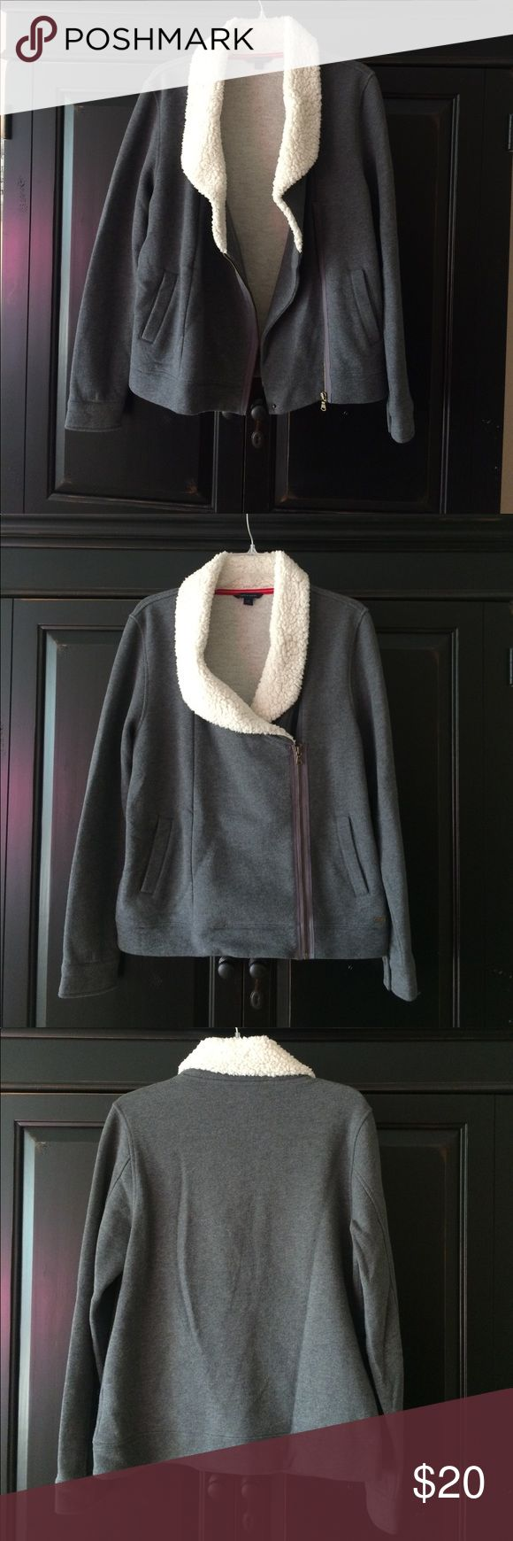 💚 Cozy sweatshirt by Tommy Hilfiger 💚 This sweatshirt is so versatile! Can be worn zipped up and worn as more of a jacket or open. Looks darling with jeans or even over a dress. Entire interior is soft, cozy, and fleece lined. This has never been worn or washed, literally brand new and in perfect condition. Beautiful dark grey color and fleece collar is cream. Tommy Hilfiger Tops Sweatshirts & Hoodies