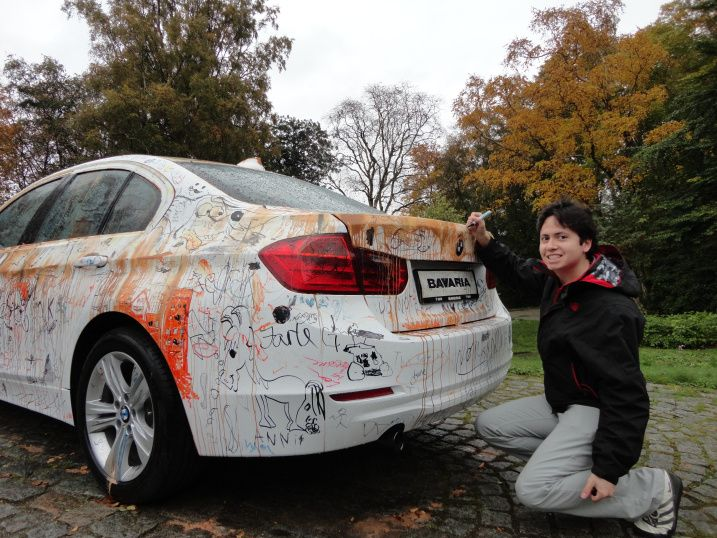 Writing on a BMW? Oh yes...  http://northernfjords.com/2012/10/01/the-stavanger-art-museum-cars-and-paintings/