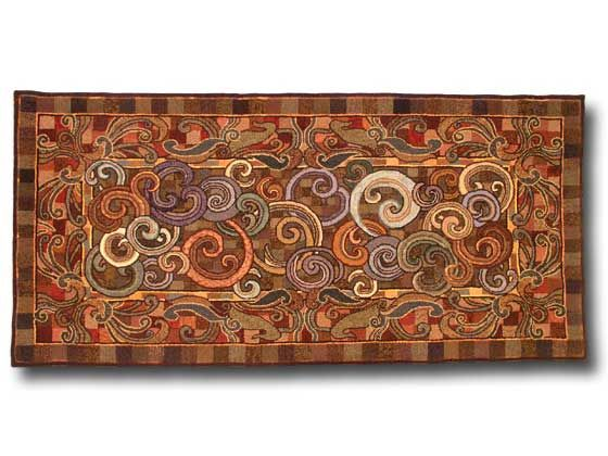 hooked rug with swirls in block background