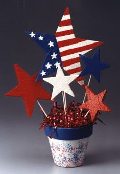 Patriotic Starburst Bouquet: Celebrate your patriotism with this Red, White, and Blue craft project. This festive bouquet makes a great quick and easy Fourth of July decoration or the perfect outdoor picnic table decoration.