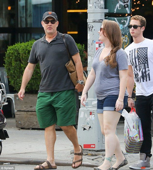 Ordinary times: Mega actor Tom Hanks spent time today with two of his children, Elizabeth and Chet