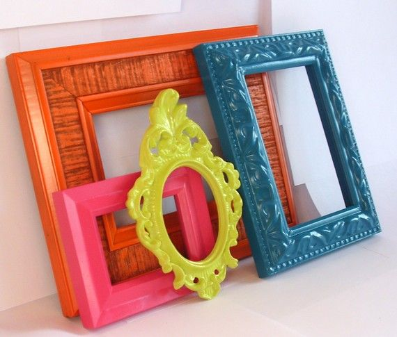This collection of 4 vintage & rescued frames are made of thick textured wood, resin, and plastic, and have been refreshed with modern shades of bright orange, hot pink, turquoise blue, and lime green.