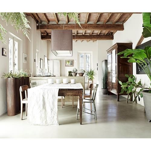 A landscape designer's love of plants is reflected in his rustic countryside home which is decorated from the floor up with an eclectic mix of plants.