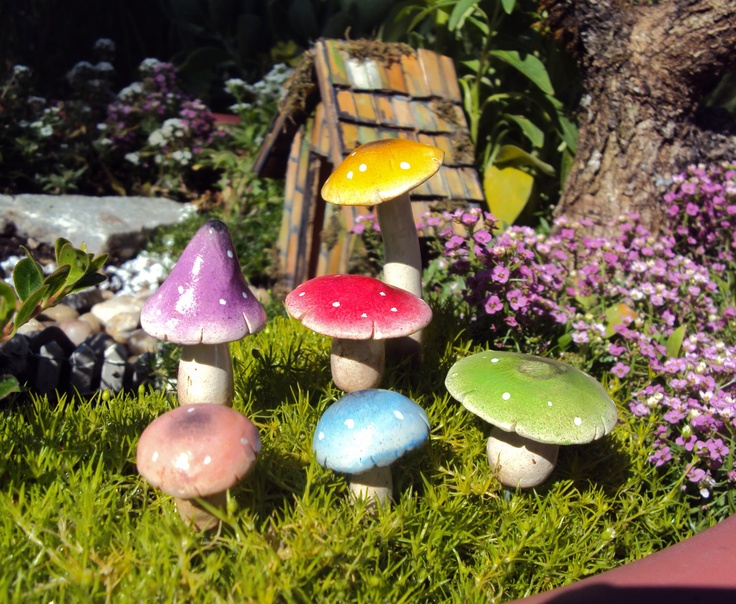 Polymer clay fairy garden.  I want to find these or make them.