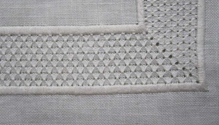 Hem with a mitred corner - combination of Satin stitch bars and Honeycomb Darning stitches