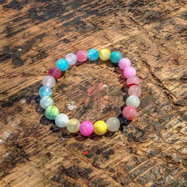 This lovely colored beaded mineral bracelet is made of Jade with a hematite star. Loving Beads