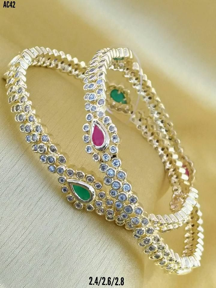 Beautiful bangles studded with white pink and green color kundhans. 07 September 2017.
