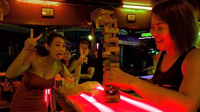 """A game of Jenga with Amy. She manages Rumour's bar in Bangkok Sukhumvit Soi 22.  One of a few bars in Queen's Park Plaza, where regulars meet up. A total different change to Nana Plaza and Soi Cowboy.  28 August 2017 #bangkok #bangkoknightlife #pubgames #ladyboy #worklife #bartendress #thailand #photography #photodocumentary #travelgram #jenga"" by @vic.kin. #fslc #followshoutoutlikecomment #TagsForLikesFSLC #TagsForLikesApp #follow #shoutout #followme #comment #TagsForLikes #f4f #s4s #l4l…"