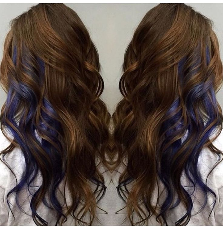 Brunette with mid layer perks of blue