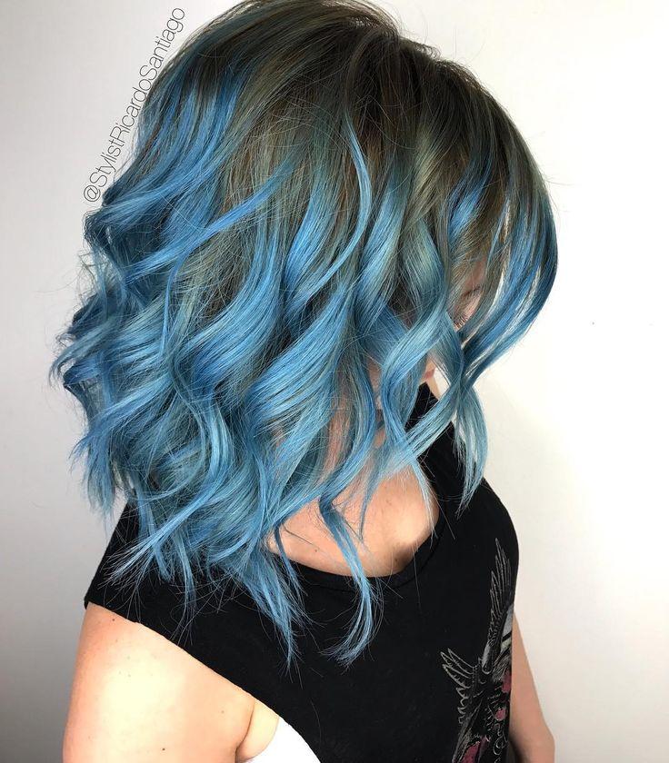 Light blue faded hair color @stylistricardiosantiago ...