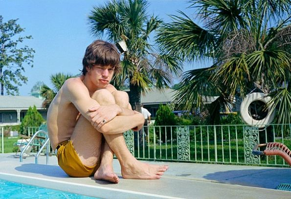 Mick Jagger on the diving board at the Manger Town and Country Motor Lodge in Savannah during the Rolling Stones' American tour, May, 1965.
