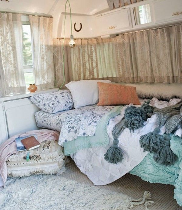 The front of the Airstream turns into a full-size bed to create a comfy, cozy bedroom. All of the colors and patterns work together in perfect harmony.
