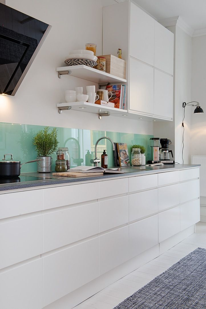 Beautiful backsplash with white cabinets.
