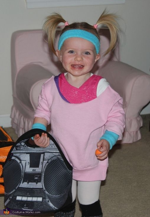 Jennifer: Lila is an 80's chick. Complete with leotard and sweatbands. She is carrying her boom box bag completed with girls just want to have fun playing.