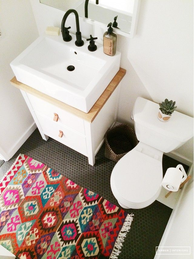 Small powder room makeover with colorful rug and contemporary square sink | ikea vanity