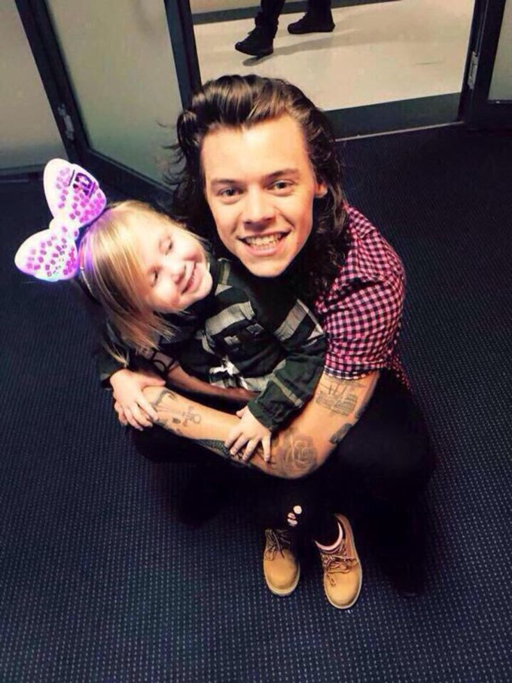 Harry Styles holding Lux will forever be my favorite thing in the world