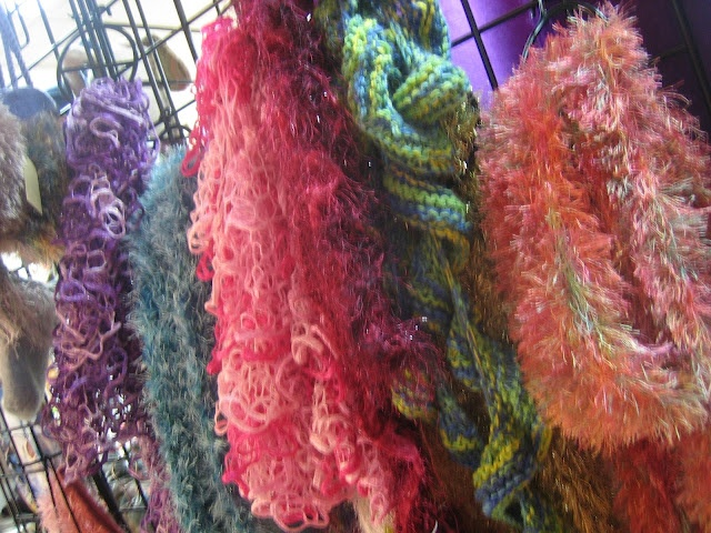 Textures:a combined effort of area artisansa.k.a. Textures Craftworks  -assorted knitted scarves, various artisans