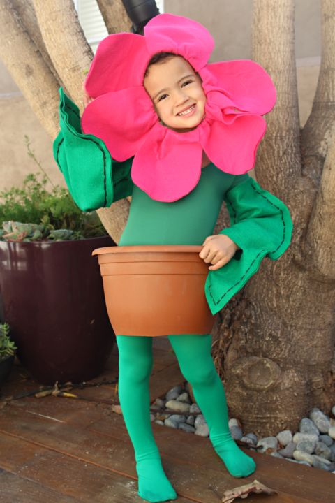 On top of a green leotard and tights, you'll need green and pink felt, dark green embroidery thread, and spray glue to make sure your little one'sflower costume will be in full bloom. Replace the flower pot with a green tutu to create aflower ballerina.  Get the tutorial at Pepper Design.