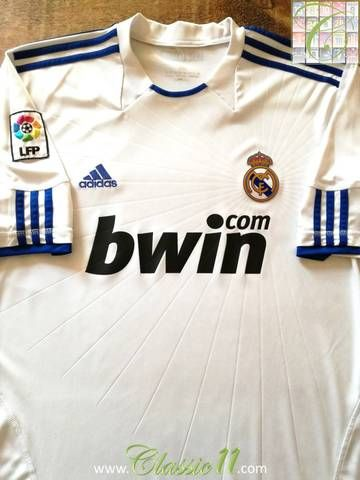 Official Adidas Real Madrid home La Liga football shirt from the 2010/11 season. Complete with La Liga patch on the sleeve.