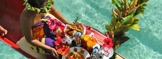 Le Taha'a Island Resort & Spa offers a host of romantic activities. Couples can choose to have lunch or dinner on a private islet with options for live music or a private Tahitian fire dance show. The resort even offers private catamaran cruises!