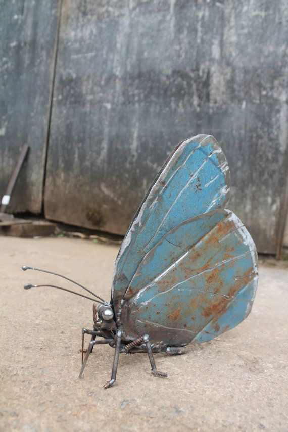 This is a sculpture made from recycled welded scrap metal which has been reclaimed and put to good use.    The subject is a Holly Blue