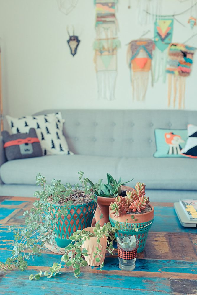 Beautiful art decorations with plants in the foreground on a grunge center table.
