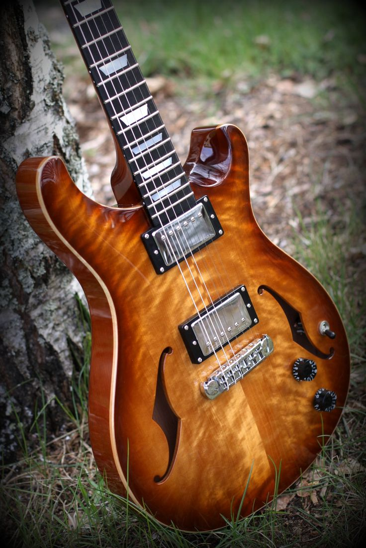 Flame birch top hollowbody PRS style guitar. Spanish cedar body and neck.