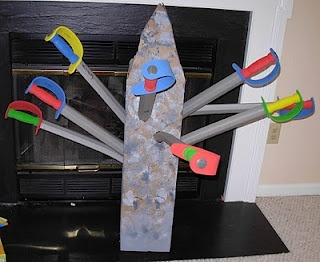 Sword in the Stone.  Neat alternative to just handing the swords out at a party.