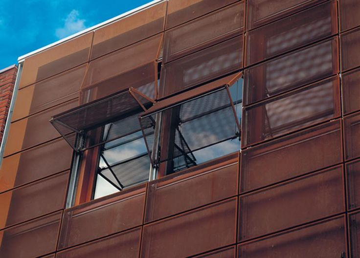 Cistom sun control fa ade by hunter douglas corten steel perforated folding panels and for Hunter douglas exterior sun shades