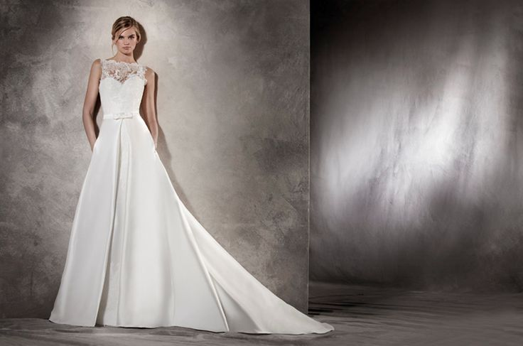 AITZIBER - This classic wedding dress breaks all outlines. It plays with the elegant volume of mikado in the front, while it fits the silhouette like a mermaid dress in the back