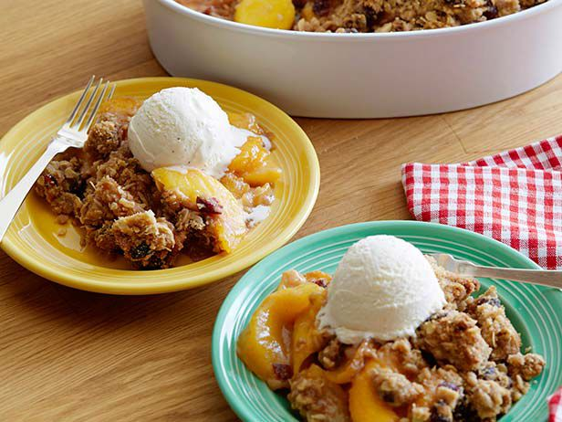 Cin-ful Peach Cobbler Recipe : Guy Fieri : Food Network Oh My Yumminess! So going to try this one. You use frozen peaches. Too easy!