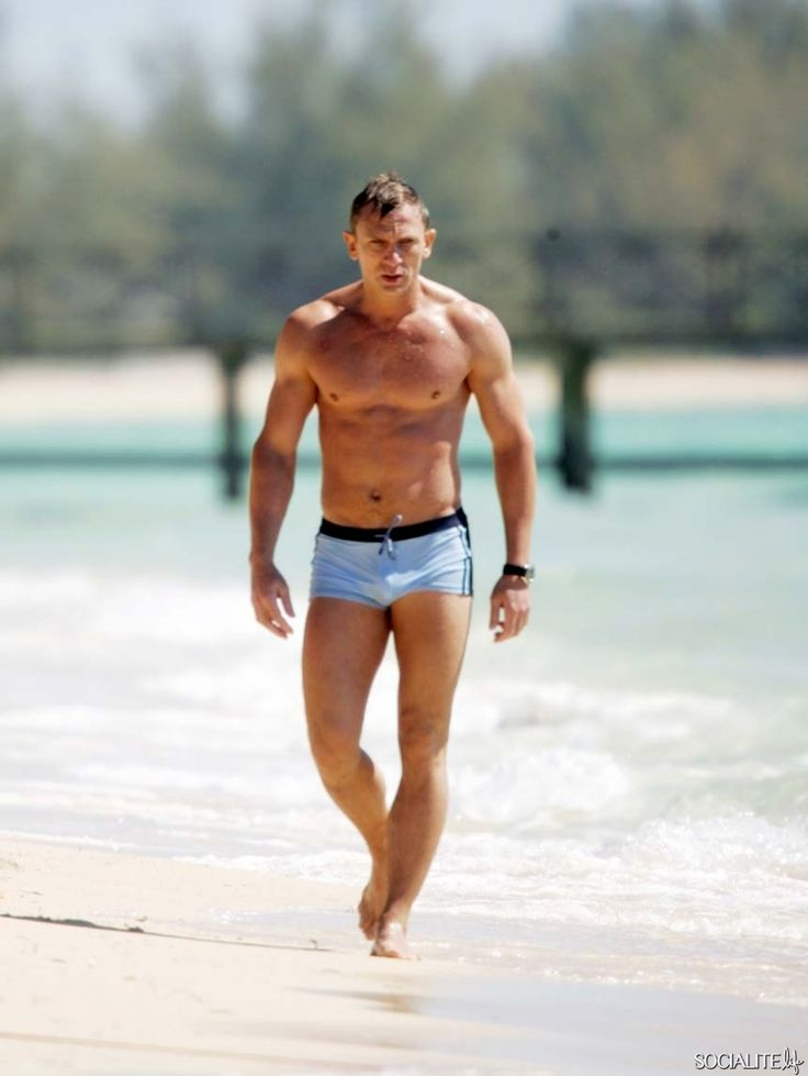 """Daniel Craig presented us as the modern era of Bond by wearing these light blue swimming trunks. Most guys prefer to wear large and broad shots these days, but the new Bond decided to turn himself in a sex symbol by wearing this tightly fit low rise short. Costume designer Hemming said, """"I wanted to put Daniel in something modern but baggy Surfy shots just wouldn't be right for Bond,"""""""