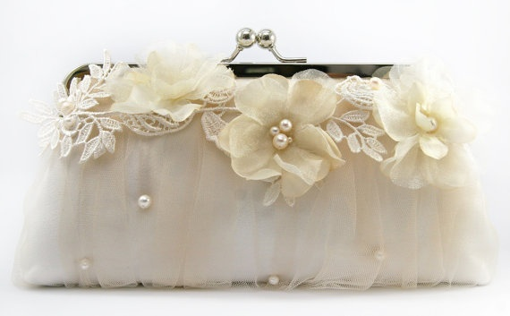 Lace and pearl clutch bag